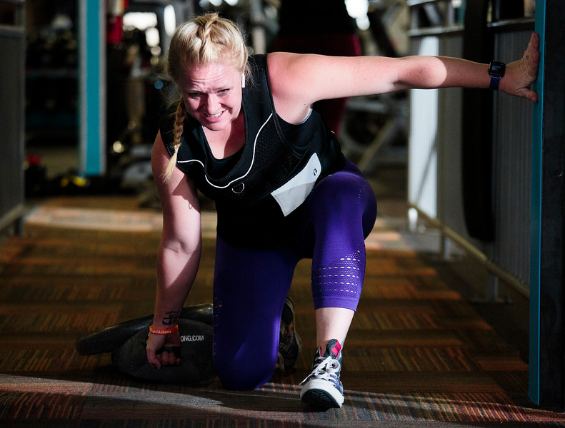 Mickey Sanderson, a personal trainer at Fitness One, hauls a weighted sandbag while wearing a 35-pound training vest as she completes a workout regimen she designed to help her with her firefighting tasks Thursday, Oct. 31, 2019 at Fitness 307. Sanderson designed and updated her training course after each new task she was introduced to during fire academy so that she would be able to complete any task required. Nadav Soroker/Wyoming Tribune Eagle