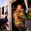 Mickey Sanderson, right, practices the call and response lingo of a crew leader from the front seat of an engine while Lt. Aaron Kamm watches and gives her prompts before an exterior fire attack Wednesday, September 18, 2019 at Laramie County Fire District 2 headquarters. The trainees go through numerous repetitions of even the most basic tasks to make sure that something as simple as talking on the radio doesn't create mistakes down the road. Nadav Soroker/Wyoming Tribune Eagle