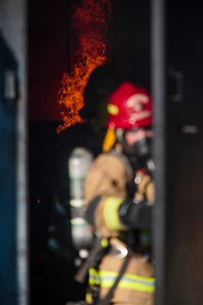 Lt. Josh Kourajian pulls the door to a shipping contained shut with all the firefighting trainees and a live fire inside for the Fire Dynamics Lesson Saturday, Oct. 19, 2019 at the Laramie County Fire District 2 practice grounds. Trainees first experience with live fire involved using the nozzle and an air flow window to see how the fire behaves in a structure. Nadav Soroker/Wyoming Tribune Eagle