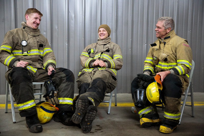 Albert Byrd, Yevgeniy Sokolov and John Ysebaert share a laugh after finishing one of their rotations during the transitional fire attack training, Wednesday, October 9, 2019 at Fire Station 1. The academy was divided into three-person crews similar to how they would respond to any emergency, with the members rotating through the roles of Crew Leader, Nozzle and Tools. Nadav Soroker/Wyoming Tribune Eagle