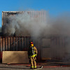 Lt. Aaron Kamm watches smoke billow out of an air flow window on top of a shipping container during the Fire Dynamics Lesson of the volunteer fire academy Saturday, Oct. 19, 2019 at the Laramie County Fire District 2 practice grounds. All the trainees were shut in the container with instructors and a live fire to see how air flow and other factors affect the fire. Nadav Soroker/Wyoming Tribune Eagle