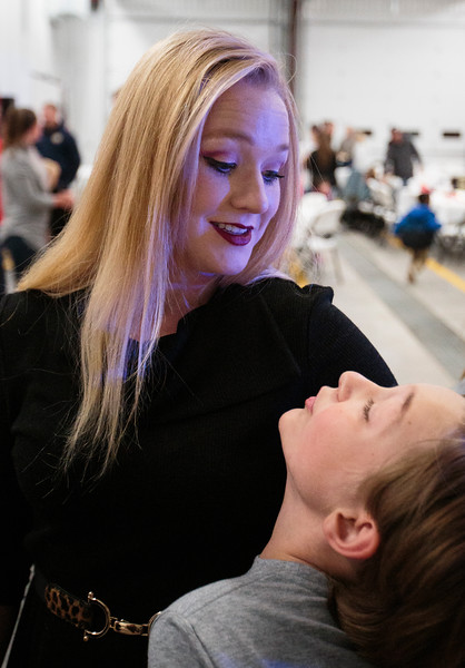 Mickey Sanderson hugs her son Jaydon Sanderson, 12, after she graduates from the department's Fire Academy Wednesday, Nov. 6, 2019 at Laramie County Fire District 2 Station 2. Nadav Soroker/Wyoming Tribune Eagle
