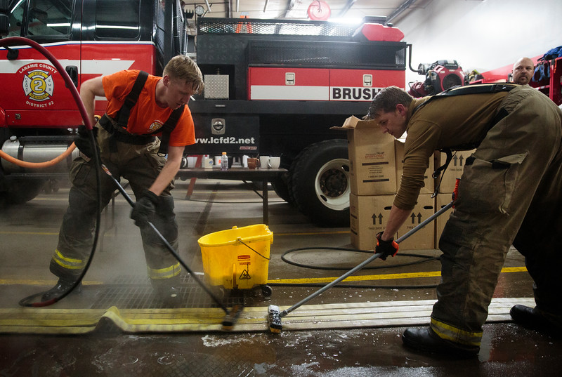Albert Byrd and Yevgeniy Sokolov wash the hoses after a long night practicing transitional fire attack, Wednesday, October 9, 2019 at Fire Station 1. Just like the fully-fledged firefighters the trainees had to clean down all the equipment after they finished with their practice to make sure it was ready for its next use. Nadav Soroker/Wyoming Tribune Eagle
