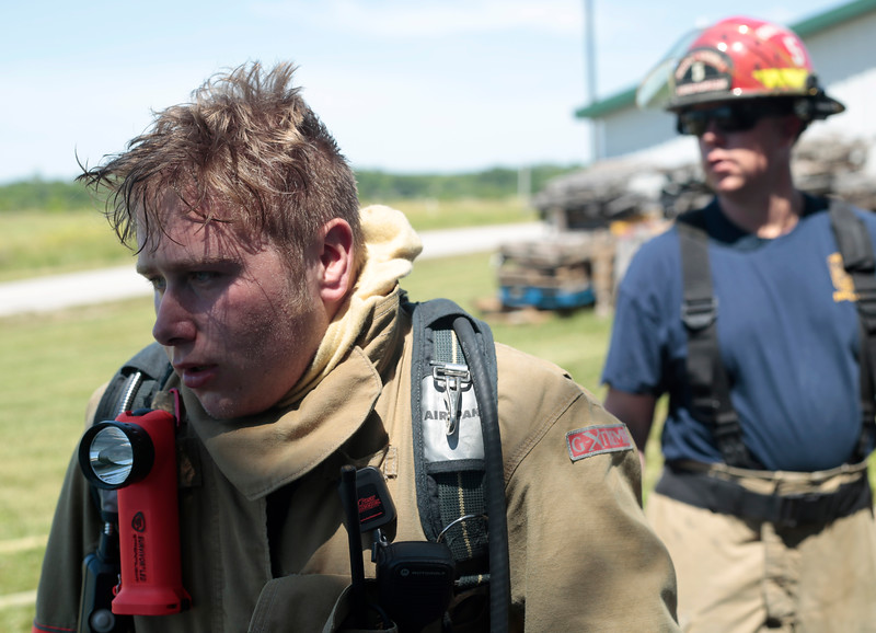 Wyatt Dawdy's hair is soaked in sweat after just a few minutes under a helmet during training on June 8. Dawdy, who took the Columbia Area Career Center's EMT class, joined the fire district training right after graduating from Hickman High School.