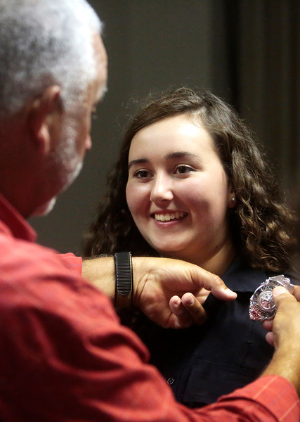 "Daryl Damron pins on his daughter Hunter Damron's badge during the Boone County Fire Protection District graduation ceremony on June 29 at the Fire District main offices. Daryl was very proud to watch Hunter graduate and join the Fire District. ""I think she'll grow up a lot in the next few years,"" he said."