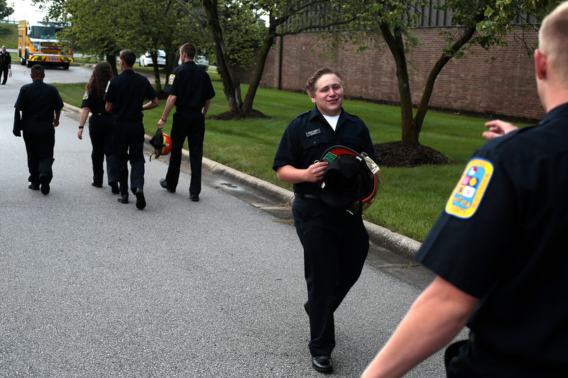 Wyatt Dawdy jokes with other recruits as they walk out to the hazmat truck to take graduation photos on June 29 at the Fire District main offices. The nine-recruit class was very tight-knit after spending a month training together from 8 a.m. to 5 p.m. five days a week.