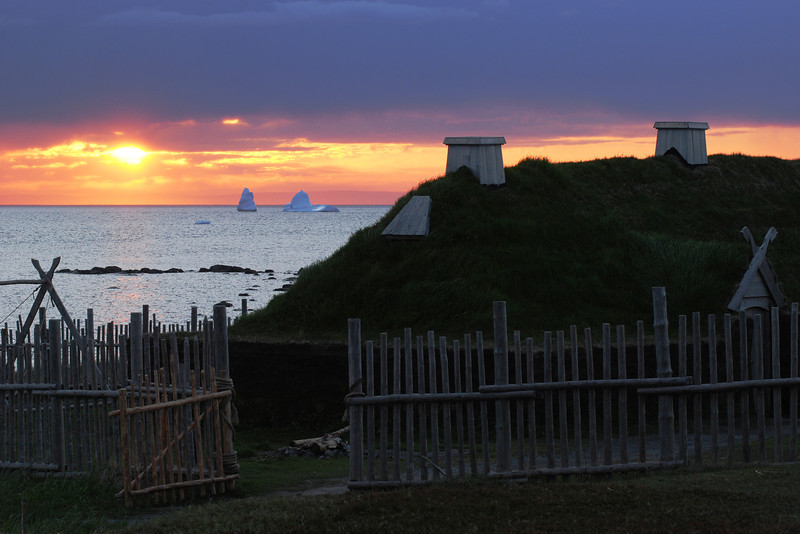 Icebergs and Viking hut at sunset - Anse-aux-Meadows
