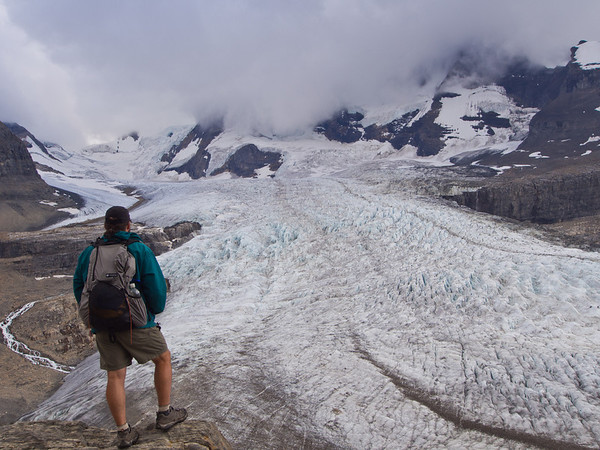 Hiker and Robson glacier from Snowbird pass route
