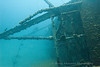 The Hilda Hooker wreck sits on its side in 26 meters of water between the coral of a double reef.
