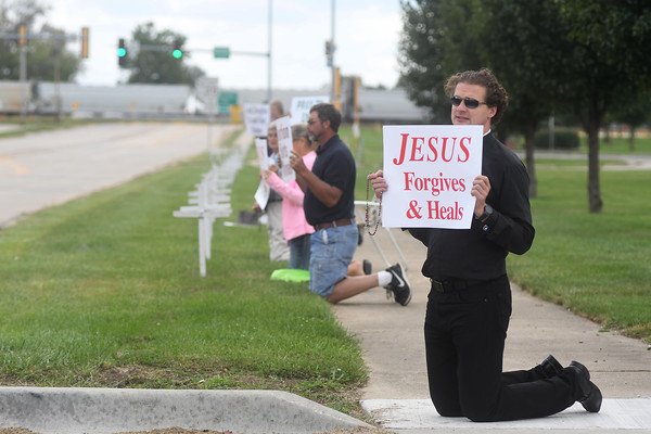 The Rev. Michal Rosa sings while kneeling along Keller Drive in Effingham during National Respect Life and Life Chain Sunday afternoon.<br /> Chet Piotrowski Jr. photo/Piotrowski Studios