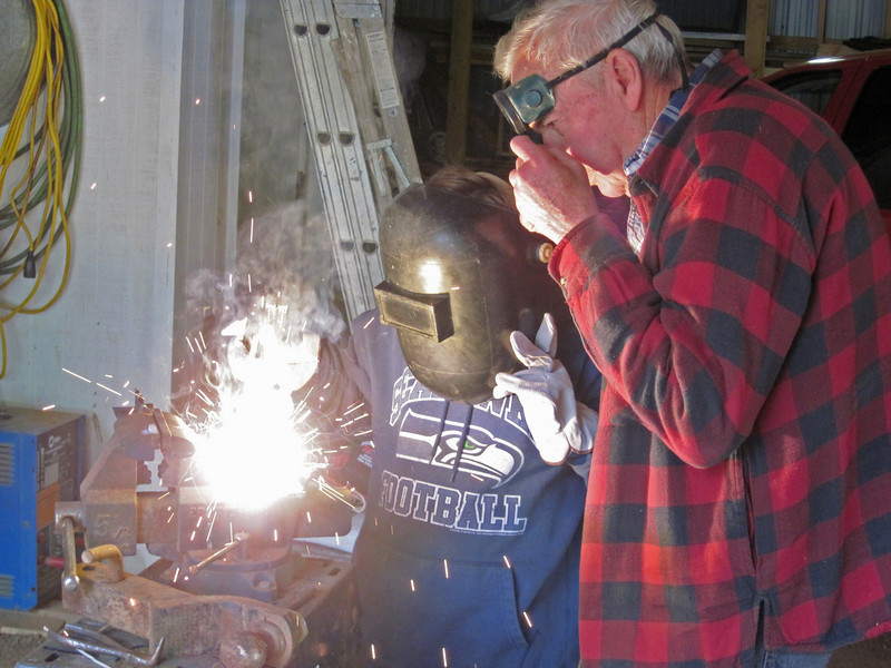 Liam learns to weld