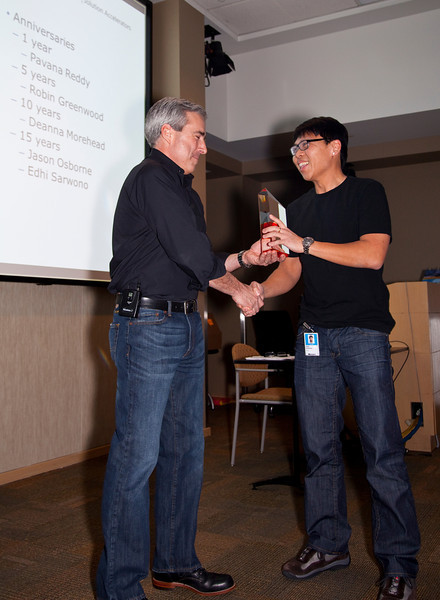Bret Clark presents 15 year service award to Edhi Sarwono