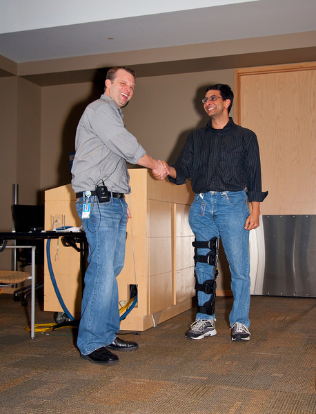 Chase Carpenter presents Golden Hammer award to Sumit Parikh