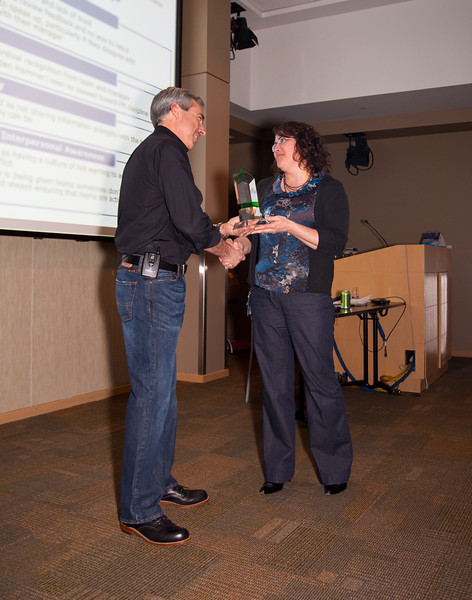 Bret Clark presents 10 year service award to Deanna Morehead