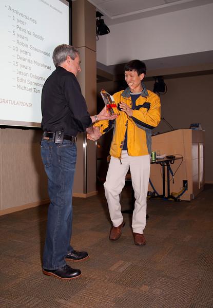Bret Clark presents 15 year service award to Michael Tan