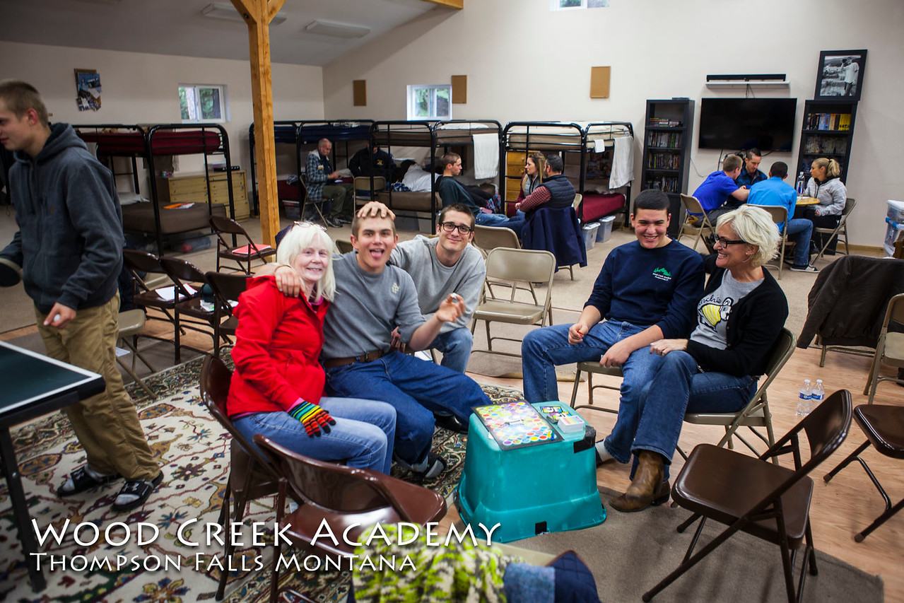 October 2017 Parents Weekend: Family groups visiting in the bunk house.