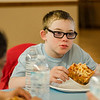 Joe Liddy, a student from the life-skills classroom at Samoset School, visit with Mayor Dean Mazzarella and enjoys some pizza during a tour of City Hall as part of Autism Awareness Month on Wednesday, April 5, 2017. SENTINEL & ENTERPRISE / Ashley Green