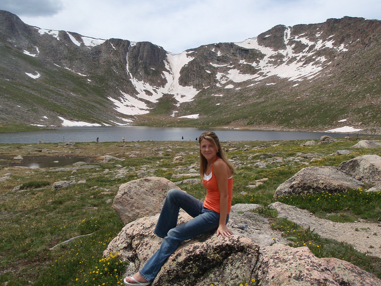 On our first day we drive up to Mt. Evans. Evans is the closest 14er to Denver and has the highest paved road in North America which takes you just below the summit. Here's Rachel at Summit Lake.