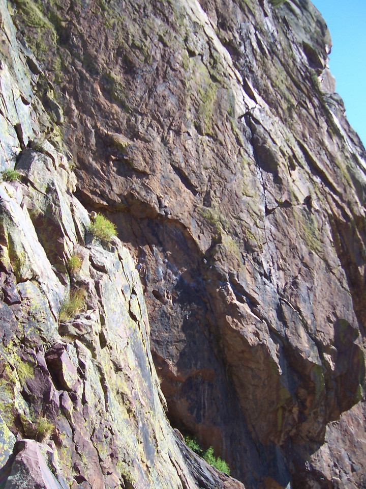 You can see a chalk line traversing the face below the small overhang. This is Rosy Crucifixion in Eldorado Canyon. After the crux traverse, which has hundreds of feet of air below it, you climb the crack up.