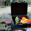 "I just love having a dry place to throw all of my gear when I'm commuting or when I walk away from the bike. I can pretty much jam anything I want in this box. I can drop my laptop backpack in here. A heavy coat. My <a target=""_blank"" href=""http://www.amazon.com/gp/product/B000OZ9VLU/ref=oh_details_o00_s01_i00"">Kryptonite U-lock</a> and cable. When I'm parked I toss in my riding gear (helmet, gloves, vest, etc). It definitely holds more than I typically take back and forth to work in my car. I just know that Marlaina is going to have me stopping by the grocery store on the way home.  :-)"