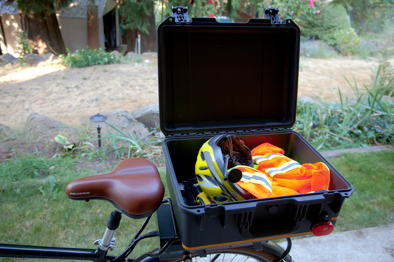"""I just love having a dry place to throw all of my gear when I'm commuting or when I walk away from the bike. I can pretty much jam anything I want in this box. I can drop my laptop backpack in here. A heavy coat. My <a target=""""_blank"""" href=""""http://www.amazon.com/gp/product/B000OZ9VLU/ref=oh_details_o00_s01_i00"""">Kryptonite U-lock</a> and cable. When I'm parked I toss in my riding gear (helmet, gloves, vest, etc). It definitely holds more than I typically take back and forth to work in my car. I just know that Marlaina is going to have me stopping by the grocery store on the way home.  :-)"""