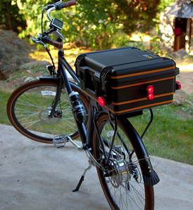 Since I am commuting rain or shine, in Seattle, I needed to have a completely dry trunk solution. So I bought a Pelican storm case and mounted it to the rear rack. These Pelican cases are guaranteed to be waterproof, dustproof, crush proof. They have a huge O-ring seal around the complete perimeter where the lid meets the case body. I added reflective tape and lights to the rear and sides for addtional safety. Works perfectly!