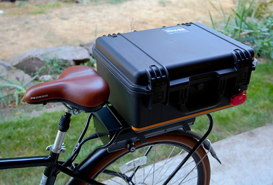 Pelican IM2450 Storm Case mounted as a trunk on the back of my bike. This has turned out to be a great solution for my needs. In this picture it just looks HUGE, but in the next picture where I am riding the bike it doesn't look like that at all.