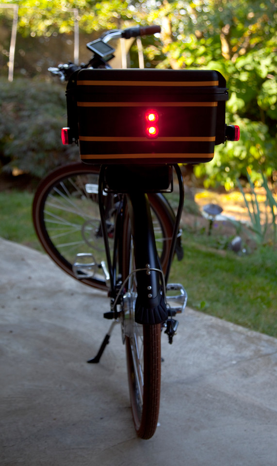 """I probably should have taken this photo with battery in the bike because that big black spot directly under the trunk is also a tail light that comes with the bike. When I converted this case to a bike trunk I also added rear and side lights for additional safety. I ride with these lights on day or night. I have to tell you that I really like this <a target=""""_blank"""" href=""""http://www.amazon.com/gp/product/B00435IPFK/ref=oh_details_o00_s01_i01"""">Portland Design Works Danger Zone</a> Tail Light. It is incredibly bright even during the daytime."""