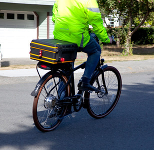 Another picture of me riding my Pedego Classic City Commuter. Here is a great shot of my Pelican Storm Case trunk also.