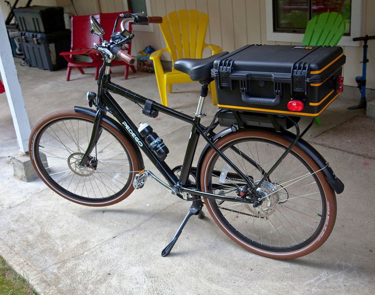 Ursus Jumbo Double Kickstand mounted and deployed on the Pedego City Commuter. Notice that with the weight of my trunk setup and electric battery, the front wheel comes up off of the ground when the kickstand is deployed. Very stable three point stand with the rear wheel.