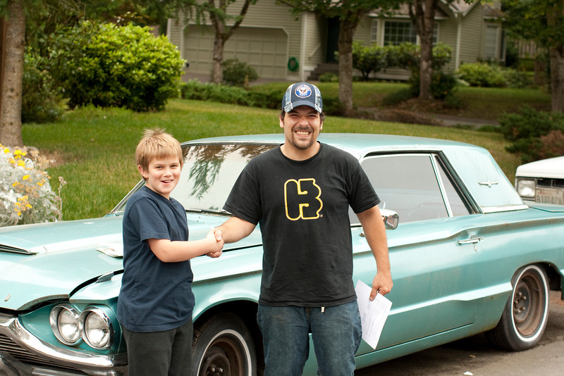 Nate is talking about this car and dreaming about this car. Finally one day I get him to walk to the door and ask about the tbird. This is Nate closing the deal to buy the bird from the former owner. This guy was a good sport and posed for pictures.