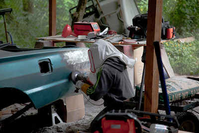 Nate has decided that sometimes he can remove more material faster with a sanding disk than he can with the sand blaster. So he has been switching back and forth. Our compressor is a little undersized so we have to wait for it to recover quite a bit. It's only a 15 gallon tank with a 1.6 horse motor.