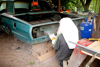Yes, we know that silica particles are bad for you. In addition to the big heavy gloves and full hood, Nate is also wearing a respirator and hearing protection. We feel pretty good about worker safety.