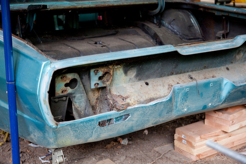 As we sort out exactly how to use the sand blaster we've decided to start with the back left corner of the car. Here you can see all of the rust on the frame ends that the bumper mounts to. We're going to see what we can do about getting all of that cleaned up in there.