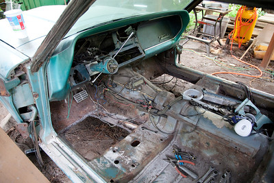 You may remember back on day 2 Nate was cutting out the rusted front floor panels. Right now it's a Flintstone car. We have the replacement panels to weld in. We just need to do quite a bit more prep before we do that step. Today while Nate was blasting I was working on getting the dash out. I'll probably be ready to pull it out tomorrow.