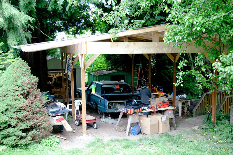 One of the things I did with the carport was to create these huge overhangs so we could set benches around while we're working that will stay dry.