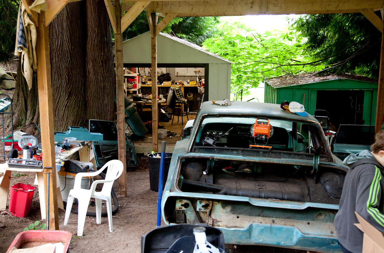 Another good shot through the carport into the tool shed. We have these huge cedar trees on our place and I never really pay much attention to how big they are. Boy, you sure can tell in this picture how big the trunk is of that one on the left.