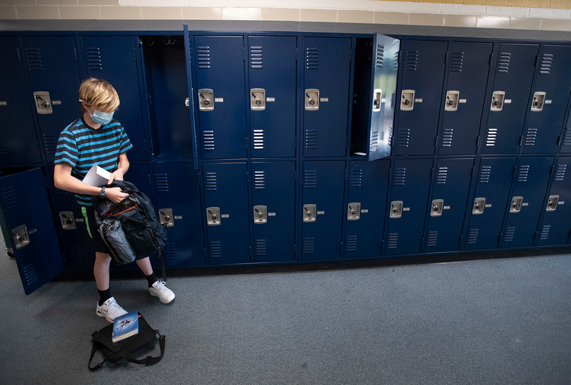 A student empties out his locker as students wrap up the end of the school year at Lesher Middle School in Fort Collins, Colo. on Thursday, May 21, 2020.