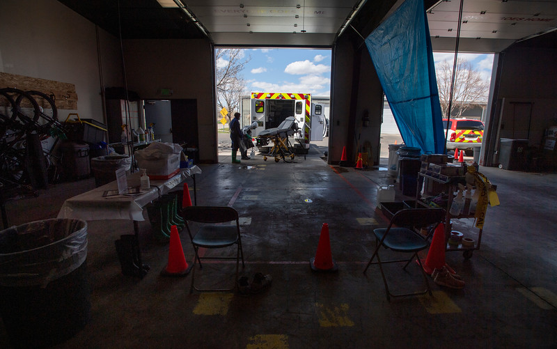 Two redeployed UCHealth medical fitness employees on the COVID-19 decon team work to decontaminate an ambulance after it transported a COVID-19 patient at the UCHealth EMS office in Fort Collins, Colo. on Tuesday, April 28, 2020.