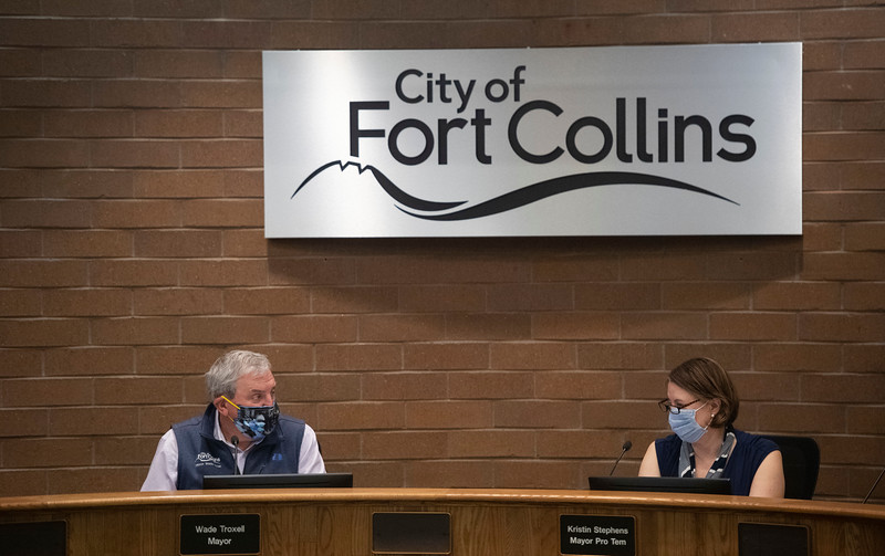 Mayor Wade Troxell and Mayor Pro-tem Kristen Stephens look at one another during the first city council meeting during the coronavirus pandemic at City Hall in Fort Collins, Colo. on Tuesday, May 19, 2020.