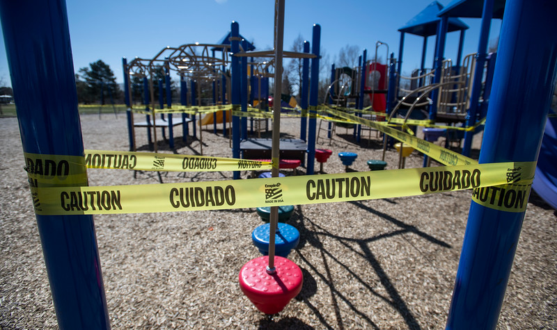 Caution tape is seen around the playground equipment at Lopez Elementary School during the coronavirus pandemic in Fort Collins, Colo. on Tuesday, April 7, 2020.