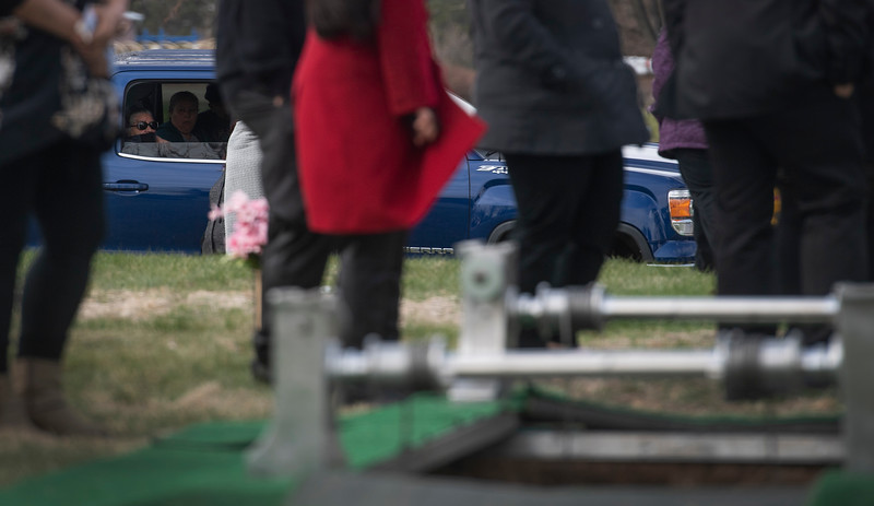 Mourners sit in their vehicle during the funeral of Saul Sanchez, a longtime JBS employee that died of the coronavirus disease, at Sunset Memorial Cemetery in Greeley, Colo. on Wednesday, April 15, 2020.