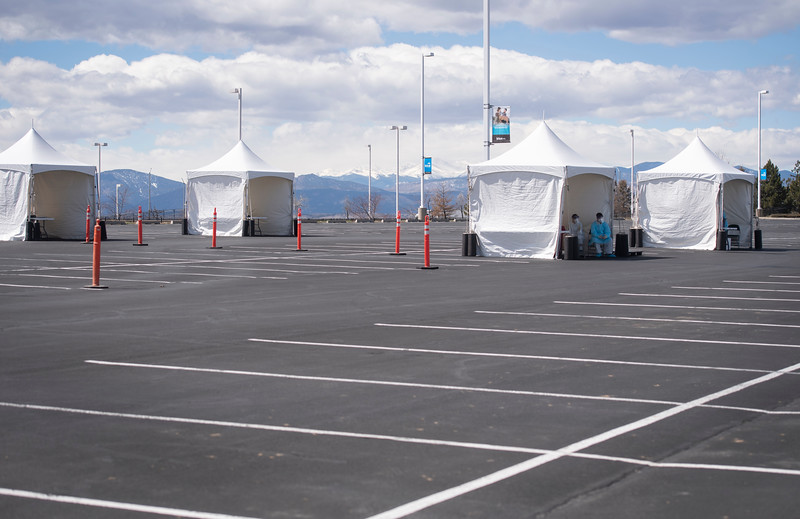 The Larimer and Weld County Departments of Public Health and Environment test first responders for the novel coronavirus at a drive-thru testing station at The Ranch events complex in Loveland, Colo. on Monday, March 30, 2020.