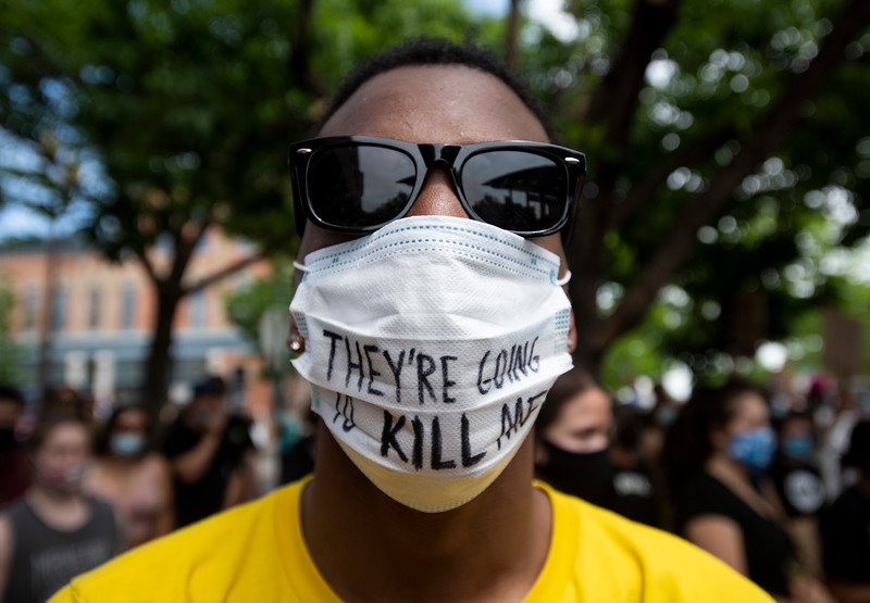 """Mark Clark, of Fort Collins, wears a face mask with the phrase """"They're going to kill me"""" written on it during a protest in Old Town Square in response to the police killing of George Floyd, an unarmed black man in Minneapolis, in Fort Collins, Colo. on Tuesday, June 2, 2020."""