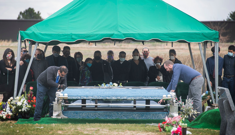 Mourners attend the funeral of Saul Sanchez, a longtime JBS employee that died of the coronavirus disease, at Sunset Memorial Cemetery in Greeley, Colo. on Wednesday, April 15, 2020.