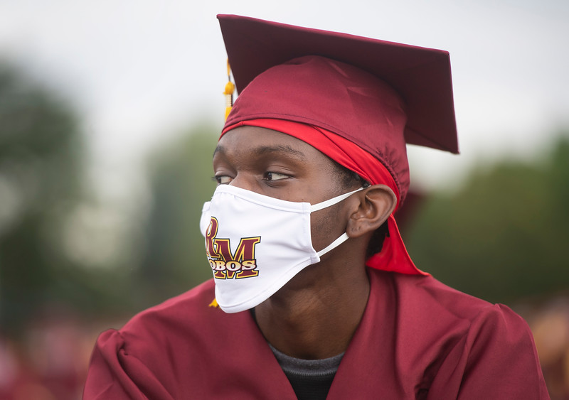 Bryan Amah listens during the Rocky Mountain High School graduation ceremony at French Field at Rocky Mountain High School Saturday, July 25, 2020. Poudre School District's graduation ceremonies were delayed and adapted to accommodate social distancing and other precautions aimed at limiting the spread of COVID-19.