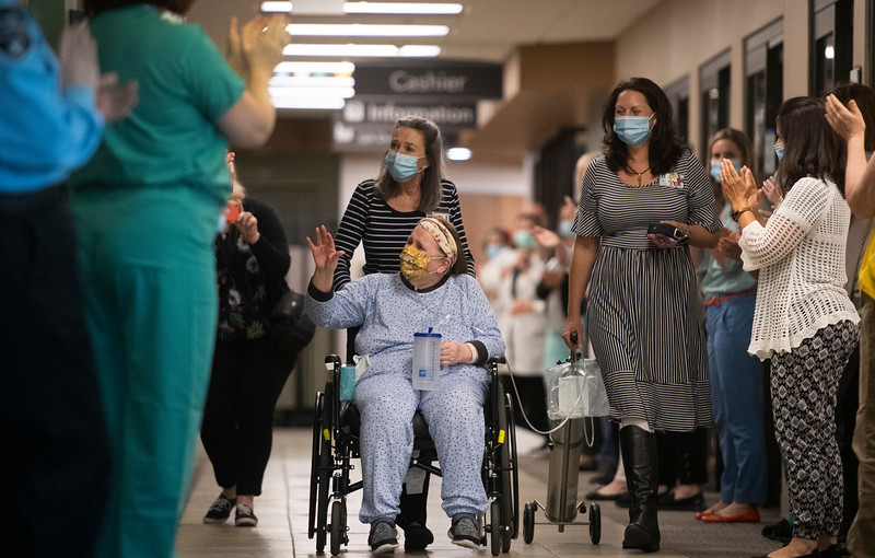 Deb Hoffman, a UCHealth nurse, receives a sendoff from the staff of UCHealth's Poudre Valley Hospital after 47 days of hospitalization battling coronavirus, or COVID-19, inside UCHealth's Poudre Valley Hospital in Fort Collins, Colo. on Wednesday, May 27, 2020.