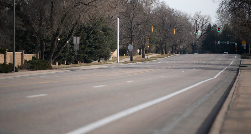 South Lemay Avenue sits nearly empty during the 5 o'clock rush hour in Fort Collins, Colo. on Monday, March 16, 2020.