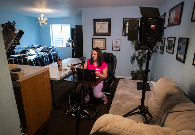 Dr. Tiffany Link gets ready to see a patient for a telehealth session in the spare bedroom in her home in Fort Collins, Colo. on Wednesday, May 20, 2020.
