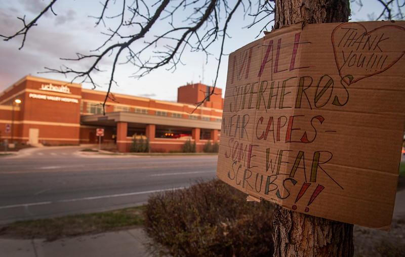 A sign thanking health care workers is attached to a tree outside the ambulance bay at UCHealth Poudre Valley Hospital during the coronavirus pandemic in Fort Collins, Colo. on Friday, March 10, 2020.